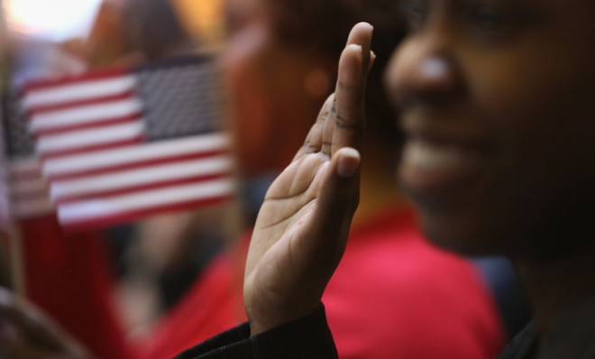 Immigrants in New York Raise their Hands for the Oath of Allegiance to The United States