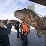 A dinosaur from Walking With Dinosaurs visits Barclays Center to promote their upcoming Summer 2014 show.