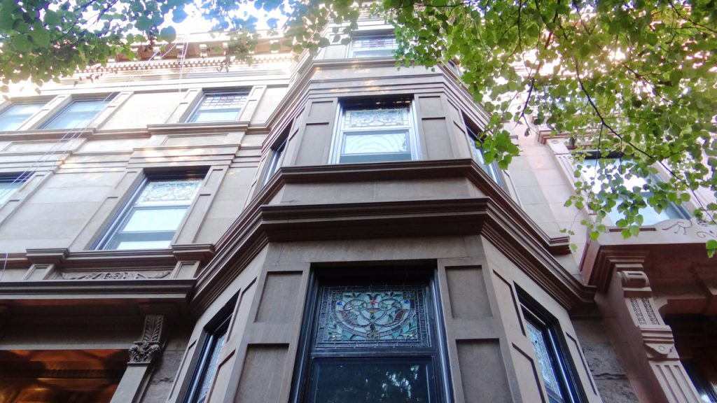 A view from outside 7 Arlington Place, the only home on the block that has maintained its original stained glass windows