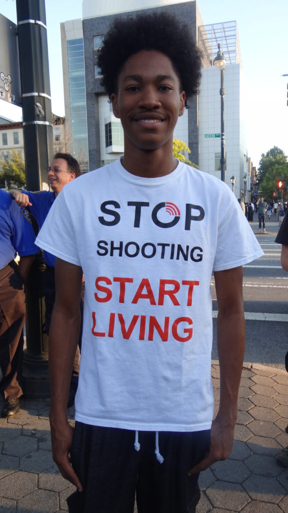Robert David, 20: What moves me to be here today is the fact that I'm a young black American child. I want to encourage other black American children to not be in the street, go home early. Your life is better than picking up a gun. Hopefully the youth will see me and want to make a change. They'll feel that they have a brighter future.