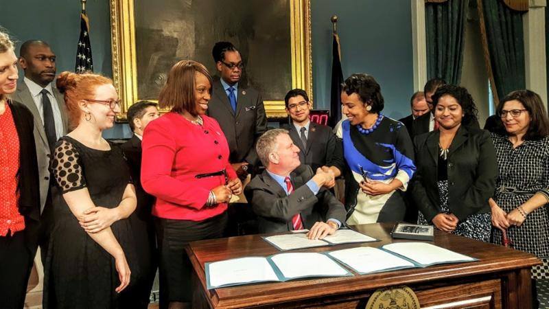 Mayor Bill de Blasio congratulates Council Member Laurie A. Cumbo after signing her bill, Intro 952 into law on Monday in the Blue Room of City Hall.